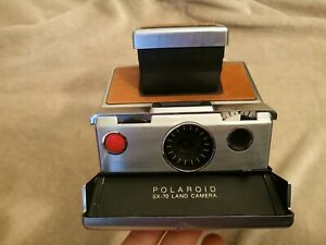Vintage Polaroid SX-70 Land Camera Silver Body Brown leather. Iconic model!
