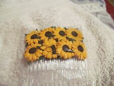 PAIR OF MULBERRY PAPER YELLOW SUNFLOWERS WITH BLACK CENTRES ON CLEAR COMBS