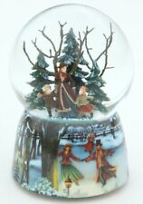 More details for musical snow globe featuring mother and children skating