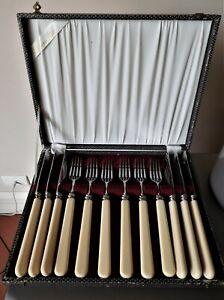 Vintage boxed six set serrated Steak knives & Forks xylonite handles. Grosvenor.