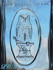 A wicked cool AND rarely seen LARGE old OWL DRUG CO antique bottle