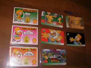 THE SIMPSONS PREPAID PHONE CARD SET of FOUR + SHELL OIL GAME CARDS ESPANOL