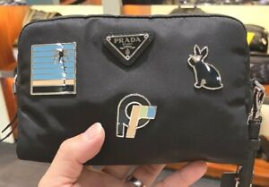 PRADA 1NE021 Black Nylon Leather Wristlet Bag With  Metal Plaques