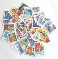 100 Christmas stamp bundle joblot on paper trimmed franked recent kiloware