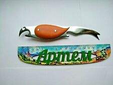 Vintage bottle opener and fish cleaning knife from the 1980s