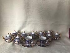 Porcelain miniature mixed set tea pots cups saucers 11 items.