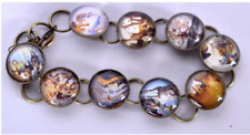 Salvatore Dali beadwork bracelet;glass domes with tiny Dali prints
