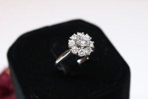 Diamant Ring,750er WG, 0,4ct. Brillant, ca.0,6ct. Besatz, VVS/G, 4,47gr.