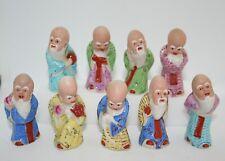 9 sages chinois, sages taoïstes, en porcelaine 5 cm de haut.