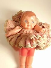 Celluloid doll with large ruffled dress: marked Japan