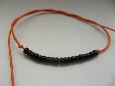 Orange tie on 19 black glass beads mala bracelet anklet metonic karmastring aum