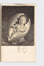 RPPC REAL PHOTO POSTCARD EASTER BABY IN EGG SHELL BUNNY EGGS DRAWN ON IMAGE