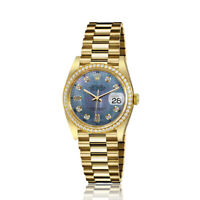 Rolex 31mm Presidential 18kt Gold Blue Tahitian MOP Mother Of Pearl Baguette Dia