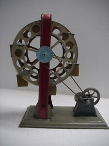 """HESS EARLY TIN GERMAN TOY CENTRIMOTOR FERRIS WHEEL WIND UP, 8"""" TALL, NICE, WORKS"""