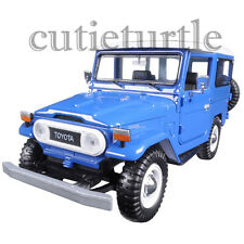 Motormax Toyota FJ 40 Land Cruiser with White Top 1:24 Diecast Car 79323 Blue
