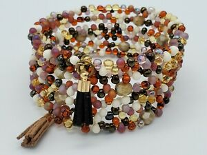 Beaded Memory wire bracelet in brown, topaz, amethyst and white. Seed bead wrap.