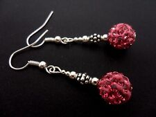 A PAIR OF DANGLY PINK SHAMBALLA STYLE     EARRINGS.