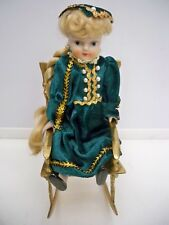 MINATURE SOLID BRASS  DOLL ROCKING CHAIR WITH PORCELAIN DOLL