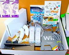 WII console NINTENDO White 2 Remotes 2 nunchakus 20 Jeux Just Dance Sports Pack