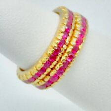 A Pair of 18K Yellow Gold Eternity Bands Set With Genuine Red Rubies