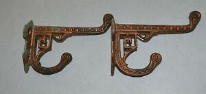 "2 fancy Antique Victorian East Lake Cast iron coat hooks 3 3/4"" long"