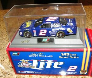 RUSTY WALLACE #2 1:43 1998 ADVENTURES OF RUSTY MILLER LITE FORD TAURUS