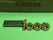 Toyota Publica 1000 Yellow / Silver Script Emblem Badge NOS
