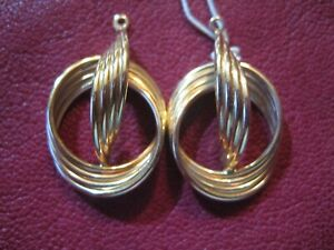 14 K Yellow Gold Swirl Knots EARRINGS JACKETS with tags 2.7 grams Old New Stock