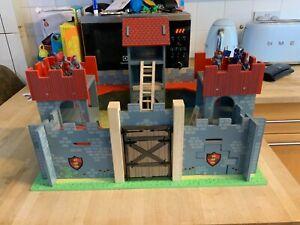 Children's Wooden Castle with drawbridge plus figures.