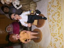 edith and archie bunker clay figures