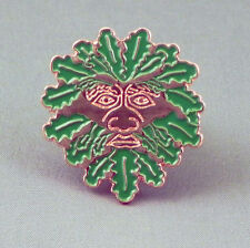 Green man pin badge. Nicely detailed pin badge. Green leaves on copper