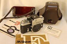 Nikon F photomic Tn  # 67XXXX body w/ original warranty  , Mint-