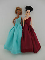 A Set of 2 Flawless Stunning One Shouldered Gowns in Wine and Green Blue Made to