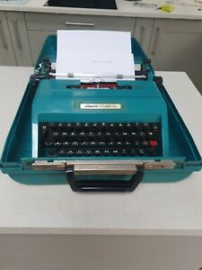 VINTAGE OLIVETTI STUDIO 45 PORTABLE TYPEWRITER IN CASE With Instructions.
