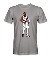 Damian Lillard Portland Trail Blazers basketball player flexing t-shirt