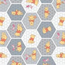 Coupon de  Tissu Disney - Winnie l'Ourson 45x55cm