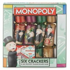 MONOPOLY CHRISTMAS CRACKERS INCLUDES MINI BOARD GAME.