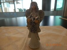 Christmas angel with white dress and silver wings