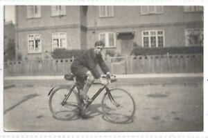 A man riding a Antique / Vintage BICYCLE