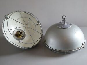 A PAIR OF VINTAGE CAGED INDUSTRIAL PENDANT BARN LIGHTS