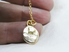 18ct nugget pendant, 18ct gold recycled jewellery, 18k star, fluid by design