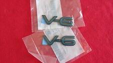 """New OEM Pair of Aqua Pontiac Grand Am """"V-6"""" Nameplate Emblem Badge 22571518"""