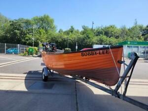 Meeching open fishing boat on trailer