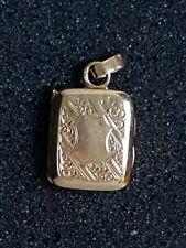 Médaillon pendentif porte photo en or 18 k  5.2 gr