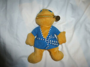 RAINBOW ZIPPY TOY.  WEARING A BLUE DRESSING GOWN.APPROX 20CM TALL