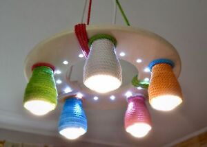 Wooden chandelier for a child's room with color cotton shades and LED spots