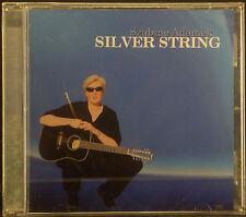 CD SZABINE ADAMEK - argento string, nuovo - conf. orig.