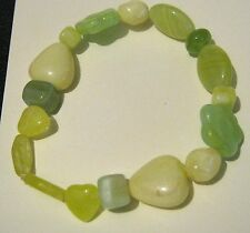 Lovely elasticated bracelet with various green hued beads and stones
