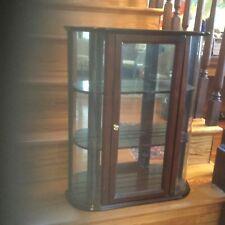 "Bombay company curio cabinet, glass back, 2 display shelves. 20 "" long, 6 "" wid"