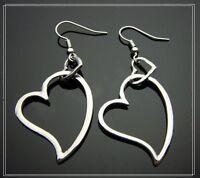 Silver tone two hearts earrings Disco, retro, glam